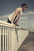 Man posing on the bridge — Stock Photo
