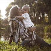 Boy in loving arms of his mother — Stock Photo