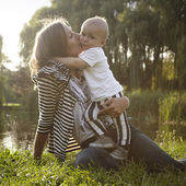 Mother with son in sunny park — Stock Photo