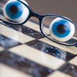 Glasses on chess board — Stok fotoğraf