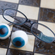 Glasses on chess board — ストック写真