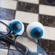 Glasses on chess board — Photo
