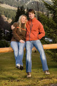 Man and woman enjoying their day in mountain park — Stock Photo