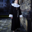 Stock Photo: Nun walking around church