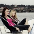Couple of friends relaxing on boat — Stock Photo