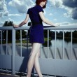 Stock Photo: Redhead in blue posing in summer light on floodgate