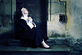 Nun sitting and preying — Stock Photo
