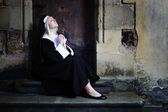 Sitting nun preying — Stock Photo