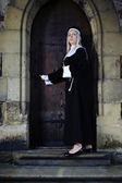 Nun entering church — Stock Photo