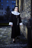 Nun walking around church — Stock Photo