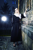 Nun looking to church — Stock Photo