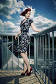 Nice lady on floodgate in wind — Stock Photo