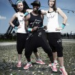 Nice fitness trio in branded dress — Stock Photo #35109899