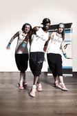 Fitness trio dancing in studio — Stock Photo