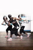 Fitness group working out in studio — Stock Photo