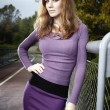 Pretty woman in violet apparel outdoor — Stock Photo