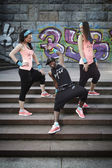 Fitness style group posing on stairs — Stock Photo