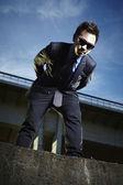 Asian man posing on the bridge — Stock Photo