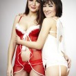 Santa lady and Angel posing in studio — Stock Photo