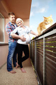 Stylish couple with pregnant lady on balcony — Photo