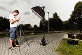 Photographer work on location — Stock Photo