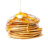 Stack of Small pancakes in syrup — Stock Photo