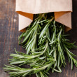 Rosemary in kraft bag - Stock Photo