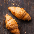 Stock Photo: Croissants on wooden background