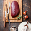 Raw liver with ingredients - Stock Photo