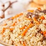 Uzbek national dish pilaf on plate — Stock Photo #24480333