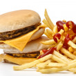 Lunch time with cheeseburger and french fries — Stock Photo