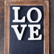 Wooden letters forming word LOVE - Stock Photo