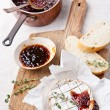Baked Camembert cheese with thyme and toasted bread - ストック写真