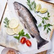 Fresh raw fish trout with herbs and lemon - Stock Photo