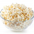 Glass bowl with popcorn — Stock Photo #24480819