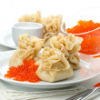 Pancake pouches with red caviar — Stock Photo