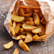 Fried potato &quot;country-style&quot; in kraft bag - Stock Photo