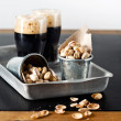Dark beer and pistachios - Stock Photo