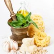 Preparing pesto in mortar - Stock Photo