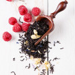 Dry tea leaves with raspberry — Stock Photo