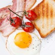 Stock Photo: Breakfast with Fried egg and bacon on plate