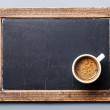 Coffee cup on vintage slate chalk board — Stock Photo #24481657