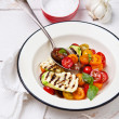 Grilled zucchini with tomato salad and basil — Stock Photo