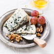 Dor Blue Cheese with honey, nuts and grapes on plate — Stock Photo