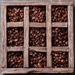 Coffee beans in wooden box — Stock Photo