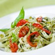 Pasta with pesto and sun-dried tomatoes — Stock Photo
