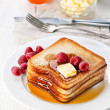 French toast with raspberries, maple syrup and butter — Stock Photo #24482187