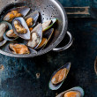 Raw washed mussels in colander — Stock Photo