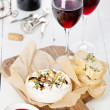 Baked Camembert cheese with red wine and toasted bread — Stock Photo #24482285