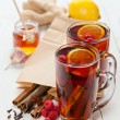 Cup of Hot winter raspberry tea with cinnamon sticks — Stock Photo